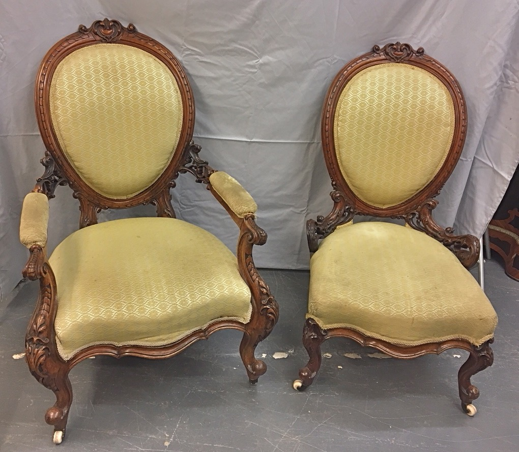 A pair of Victorian mummy and daddy walnut chairs