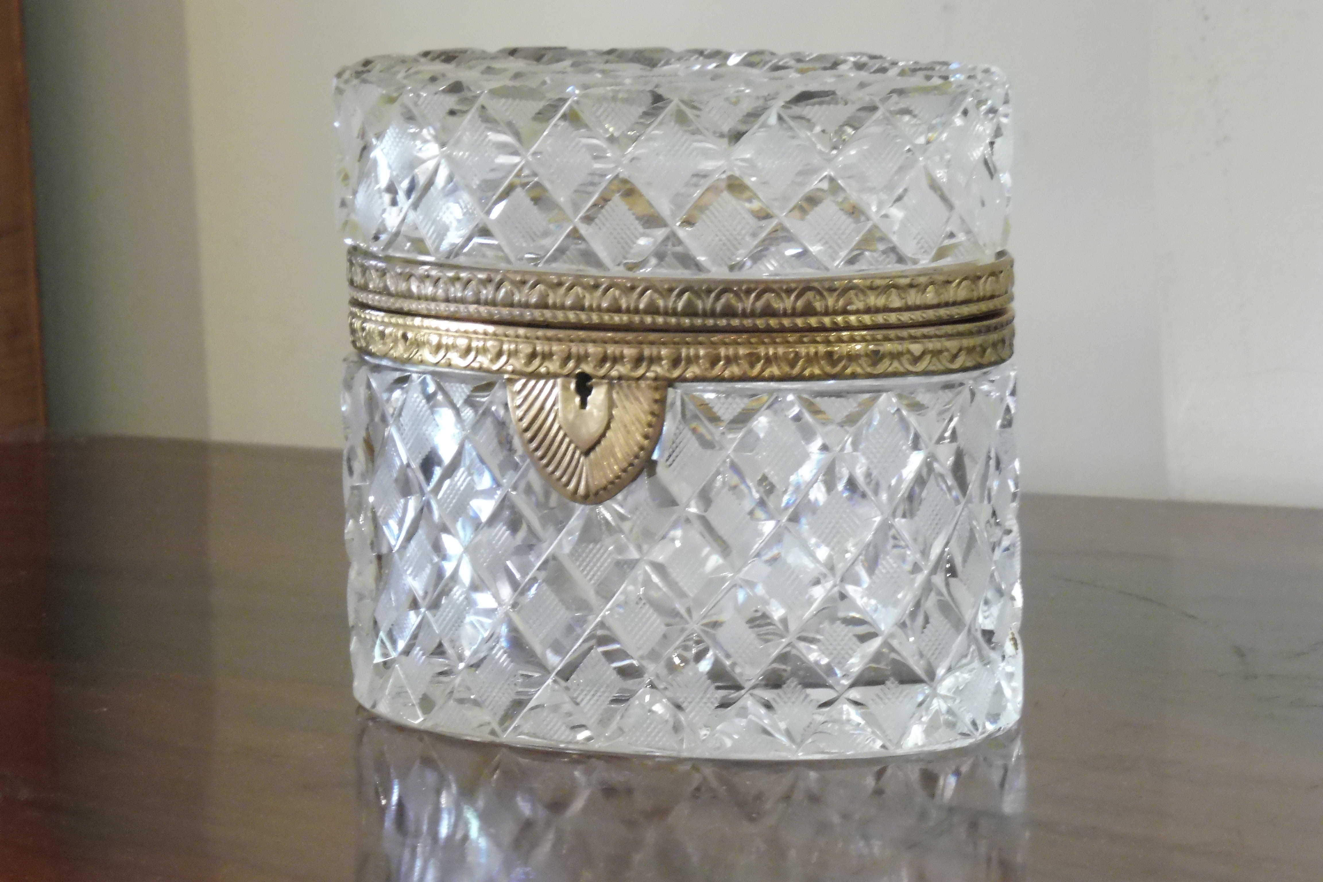 Cut crystal oval box with bronze banding