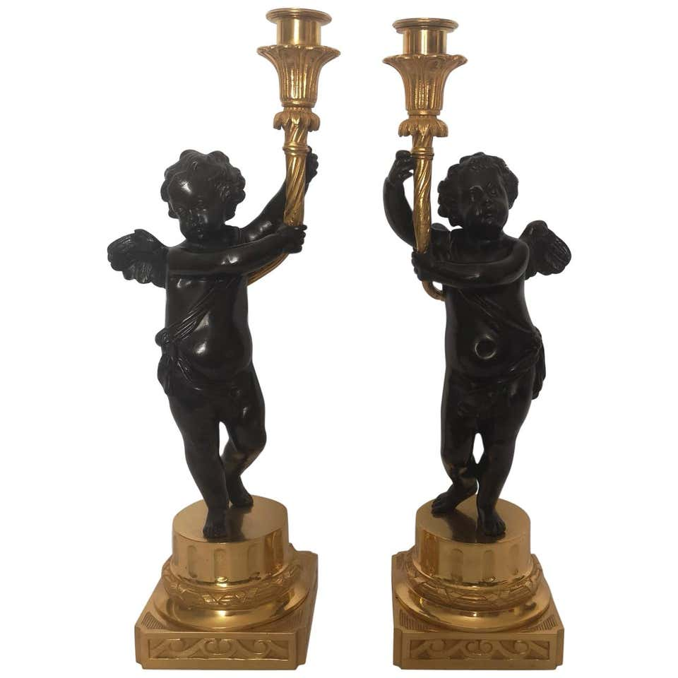 Pair Of 19th Century French Bronze And Gilt Cherub Candlesticks