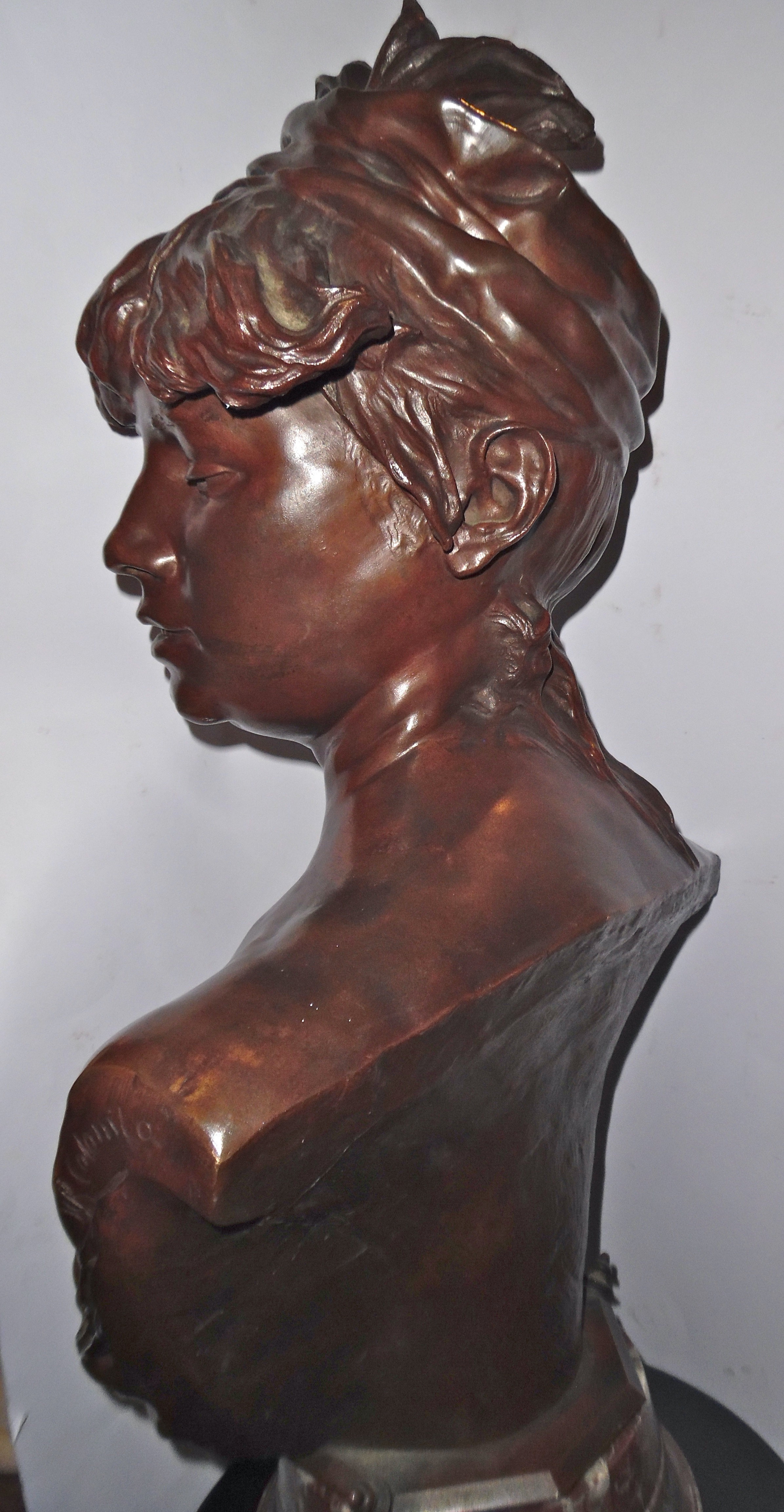 A patinated bronze bust of 'Bohemienne Orientale' by R. Colombo