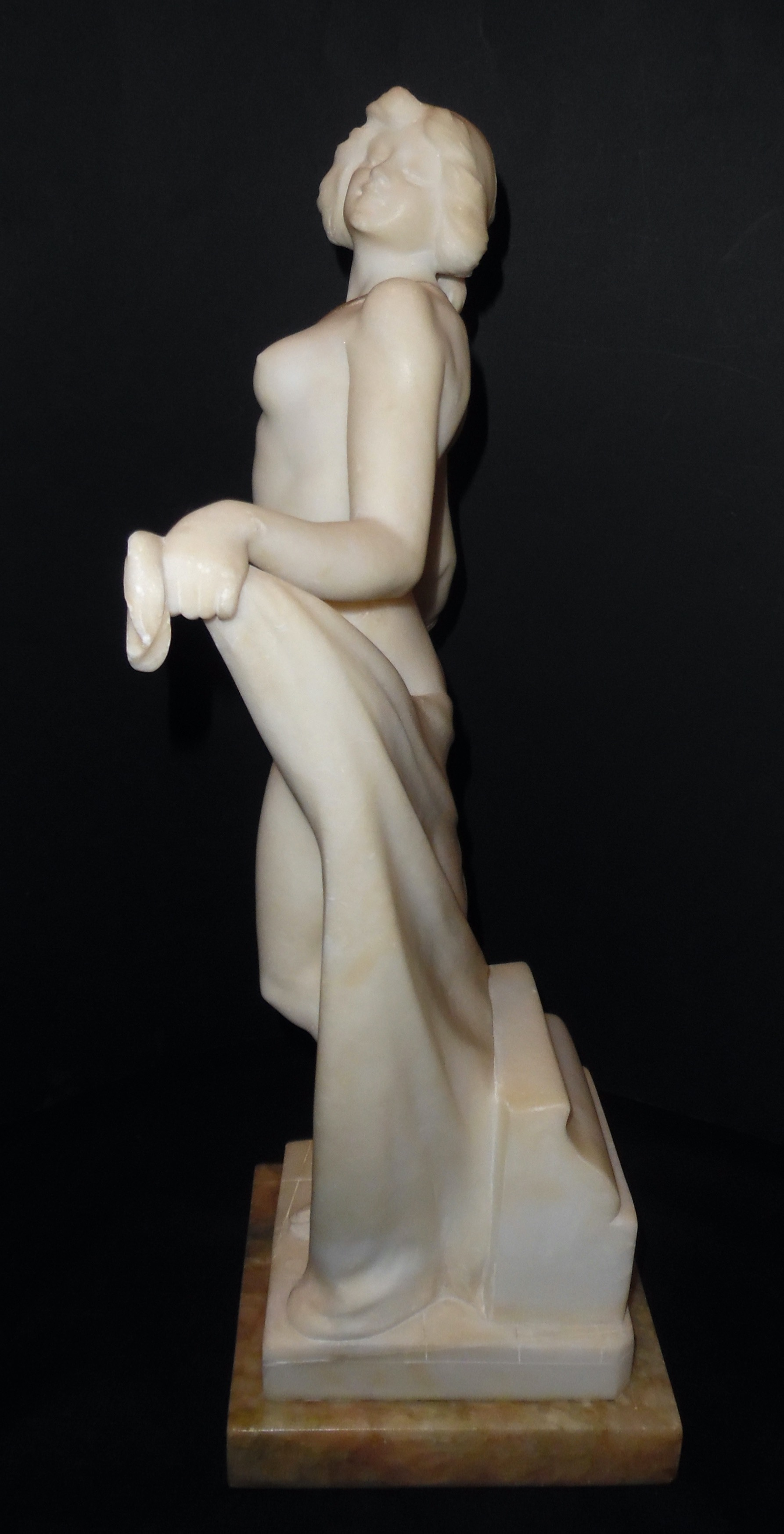 A French alabaster sculpture of a lady