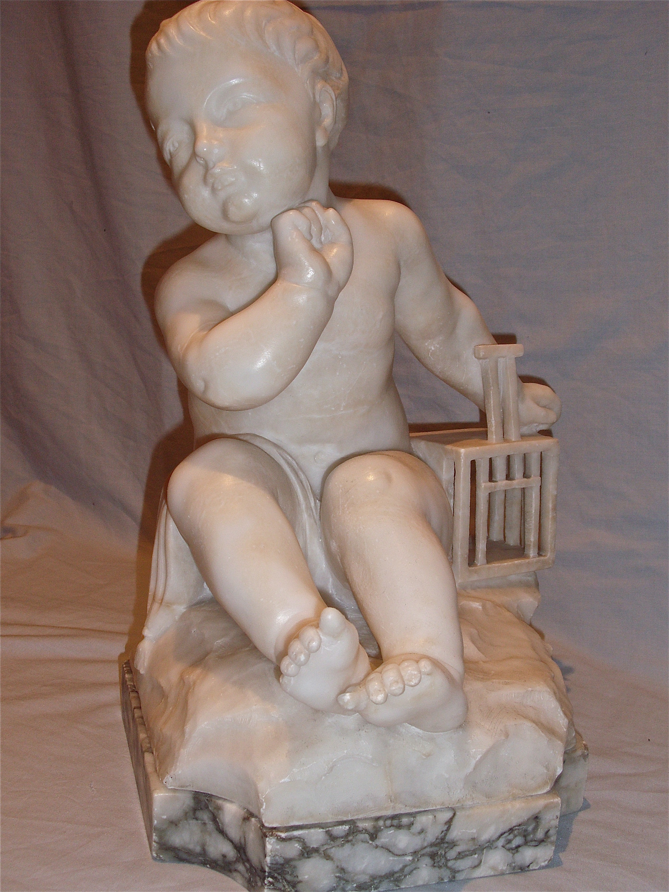 Alabaster sculpture of a Boy with Birdcage.