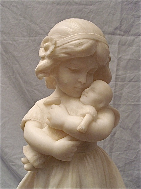 Alabaster Sculpture of a Girl with a Doll